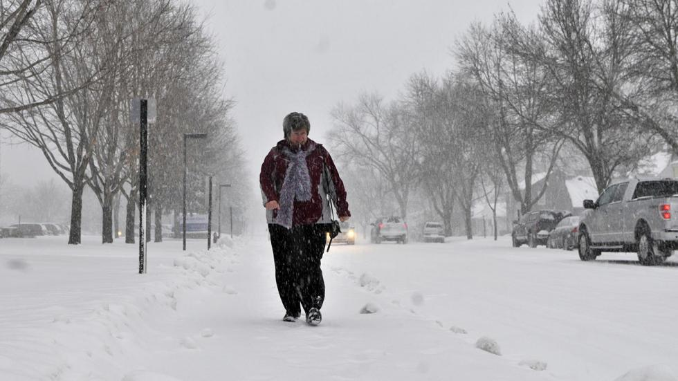 woman walking in snow twin cities winter storm astro
